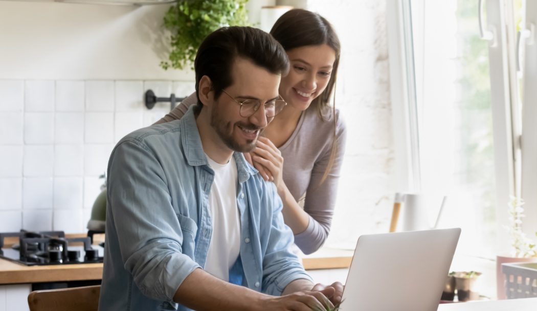Image of a young couple browsing the internet together, GVEC mesh network